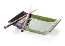 Chopsticks and plate Stock Photos