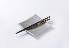 Chopsticks on plate Royalty Free Stock Photos