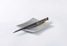 Chopsticks on plate Royalty Free Stock Image