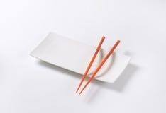 Chopsticks on plate Stock Image