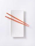 Chopsticks on plate Stock Photography