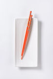 Chopsticks on plate Royalty Free Stock Images