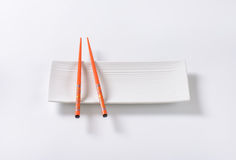 Chopsticks on plate Royalty Free Stock Photography