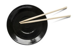 Chopsticks on a plate Stock Photos