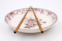 chopsticks on plate Stock Photo