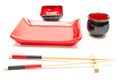 Chopsticks and plates Stock Images