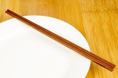 Chopsticks and plates Stock Image