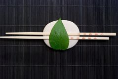 Chopsticks on platter Royalty Free Stock Photo