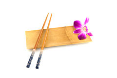 Chopsticks and Purple orchid in Bamboo dish. Royalty Free Stock Images