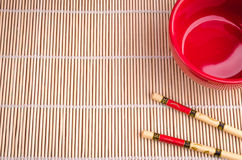 Chopsticks and red cup top view. Chopsticks and red cup of Top view with copy space Stock Photography