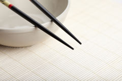 Chopsticks at rest on bowl Royalty Free Stock Photography