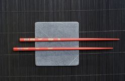 Chopsticks on rock Stock Image
