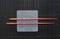 Chopsticks on rock stock image