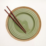 Chopsticks & Round Plate Royalty Free Stock Image