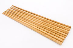 Chopsticks. A row of bamboo chopsticks on white background stock photography