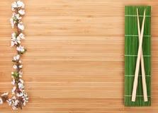 Chopsticks and sakura branch Royalty Free Stock Photography