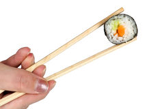 Chopsticks with salmon maki sushi Stock Photography