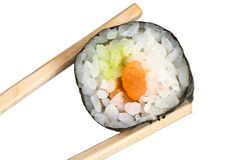 Chopsticks with salmon maki sushi Stock Images