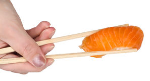 Chopsticks with salmon sushi Royalty Free Stock Photography