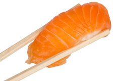 Chopsticks with salmon sushi Stock Photo