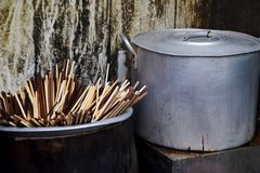 Chopsticks and saucepan in the kitchen royalty free stock image