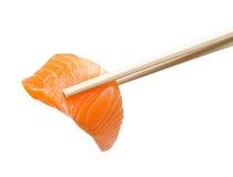 Chopsticks with sliced raw salmon Stock Photo