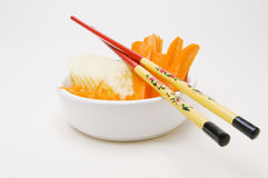 Chopsticks on a small bowl Royalty Free Stock Image