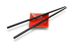 Chopsticks on small red square saucer Stock Image