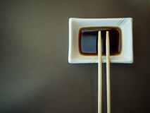 Chopsticks and soy sauce Royalty Free Stock Photo