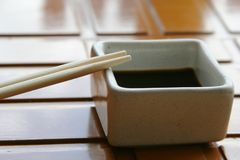 Chopsticks and soya sauce Stock Images