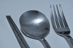 Chopsticks, Spoon and Fork. A set consisting of a pair of Chopsticks, Spoon and Fork Stock Image