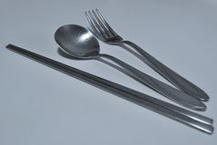 Chopsticks, Spoon and Fork. A set consisting of a pair of Chopsticks, Spoon and Fork Royalty Free Stock Photography