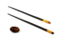 Chopsticks and stand of amber  for eastern food Royalty Free Stock Photography