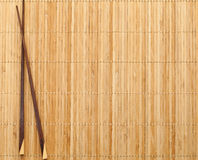 Chopsticks on straw mat. Chineese chopsticks on straw mat royalty free stock photos