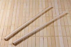 Chopsticks on a straw matt Royalty Free Stock Images