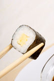 Chopsticks and sushi Stock Photography
