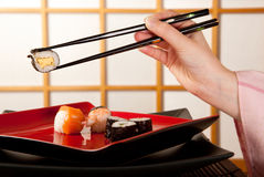 Chopsticks with sushi Stock Image