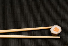 Chopsticks and sushi maki Stock Image