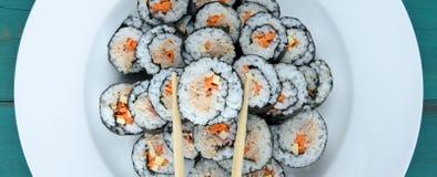 Chopsticks and sushi maki gunkan roll platter set Royalty Free Stock Image