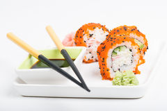 Chopsticks and sushi on the plate Stock Photography
