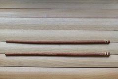 Chopsticks for sushi on the wooden surface. Chinese culture, traditional food. Wooden chopsticks for sushi Stock Images