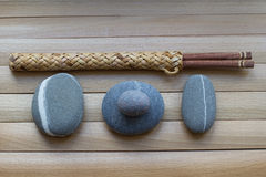 Chopsticks for sushi on the wooden surface. Japanese culture, traditional food. Wooden chopsticks for sushi. Rocks on the wooden table. Pebbles. Zen, asia Stock Photos