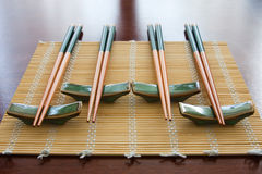 Chopsticks on table mat. Chopsticks with rests on table mat stock photography