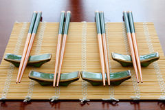 Chopsticks on table mat. Chopsticks with rests on table mat stock image