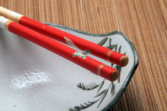 Chopsticks on top of a bowl. Red chopsticks on top of a bowl Stock Images