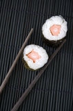 Chopsticks with two sushi Royalty Free Stock Image