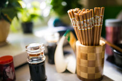 Chopsticks and vinegar Royalty Free Stock Photography