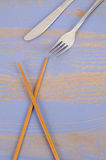 Chopsticks vs knife and fork Royalty Free Stock Photos