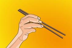 Chopsticks w ręce Fotografia Royalty Free