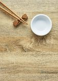 Chopsticks and white bowl. On wooden table background.Flat lay,Copy space. Design, Sunlight at noon, Japanese style royalty free stock images